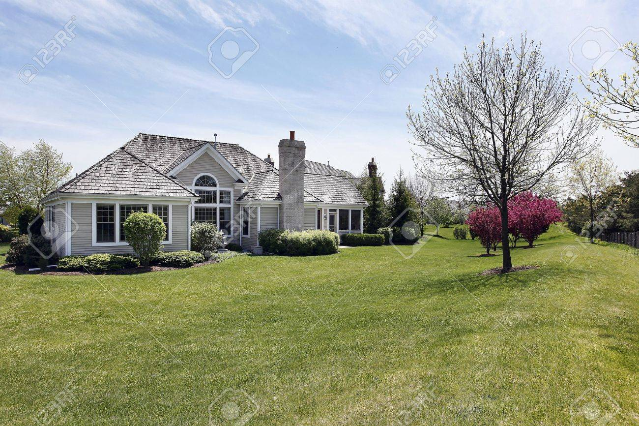 Rear view of suburban home with large back yard Stock Photo - 7809850