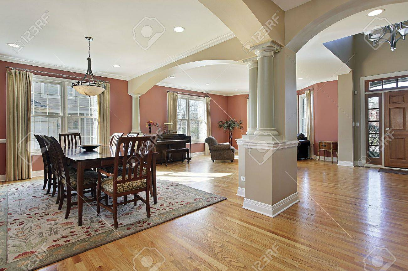 Dining Room In Open Floor Plan With Foyer View Stock Photo