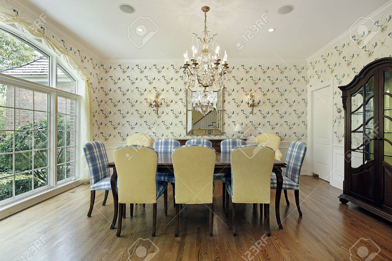 dining room with yellow and blue plaid chairs stock photo picture