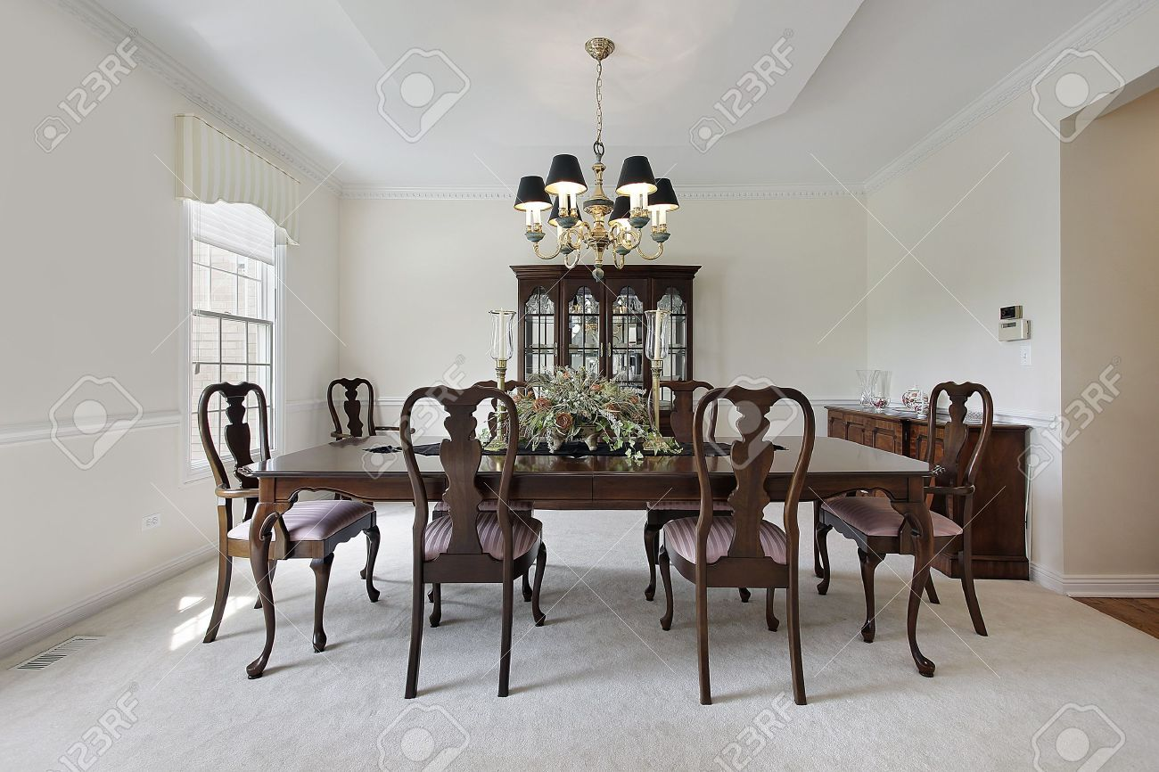 traditional formal dining room with white carpeting stock photo - Carpeted Dining Room