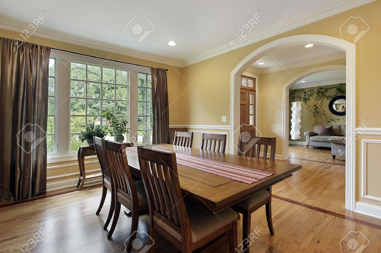 dining room with yellow walls and foyer view stock photo picture