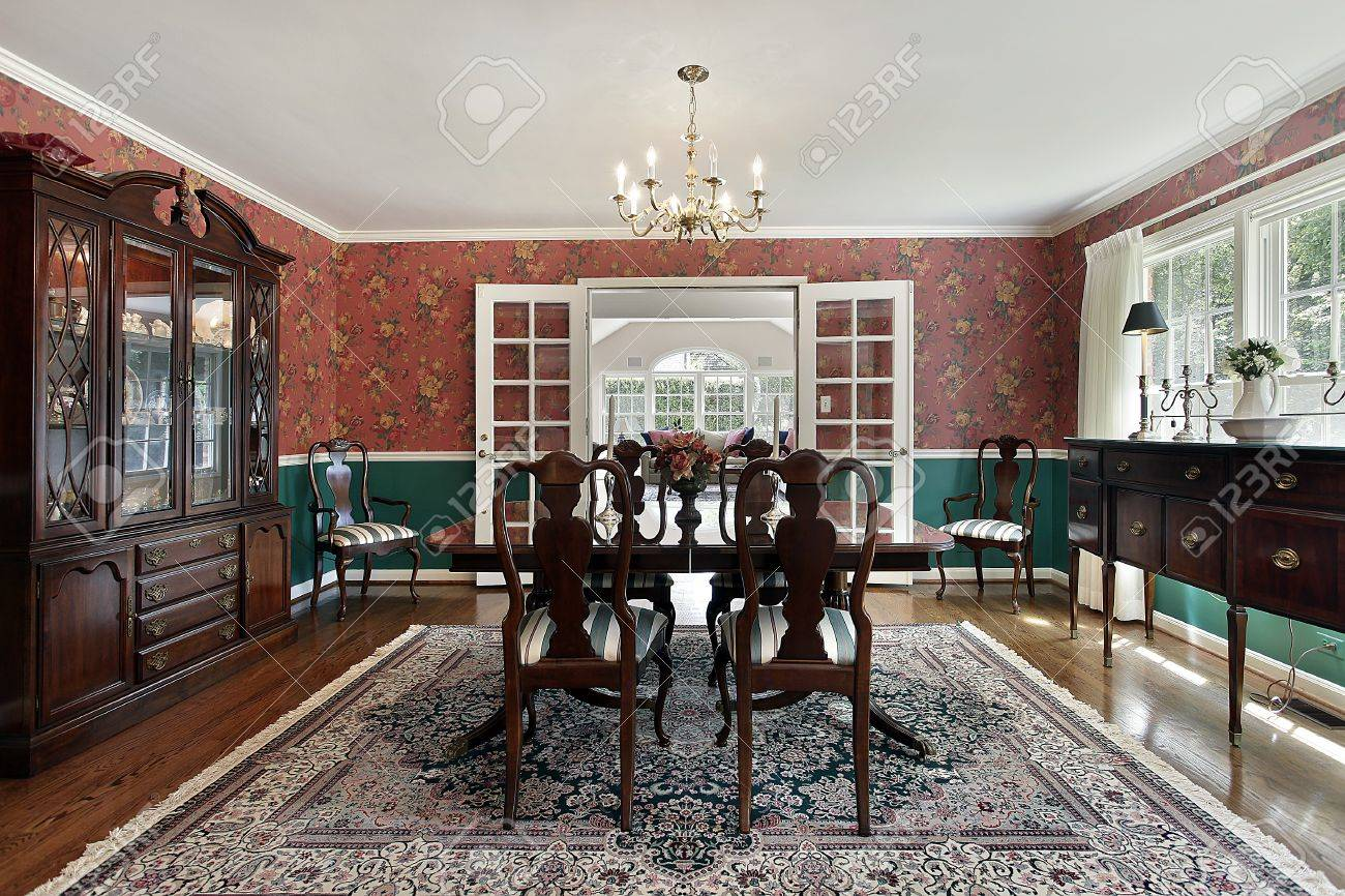 Formal Dining Room With French Doors And Red Walls Stock Photo