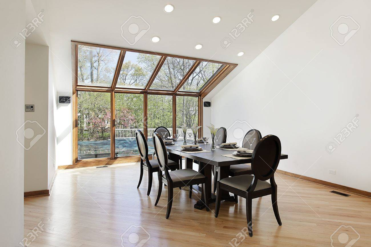 large dining room with wood trimmed skylights stock photo picture