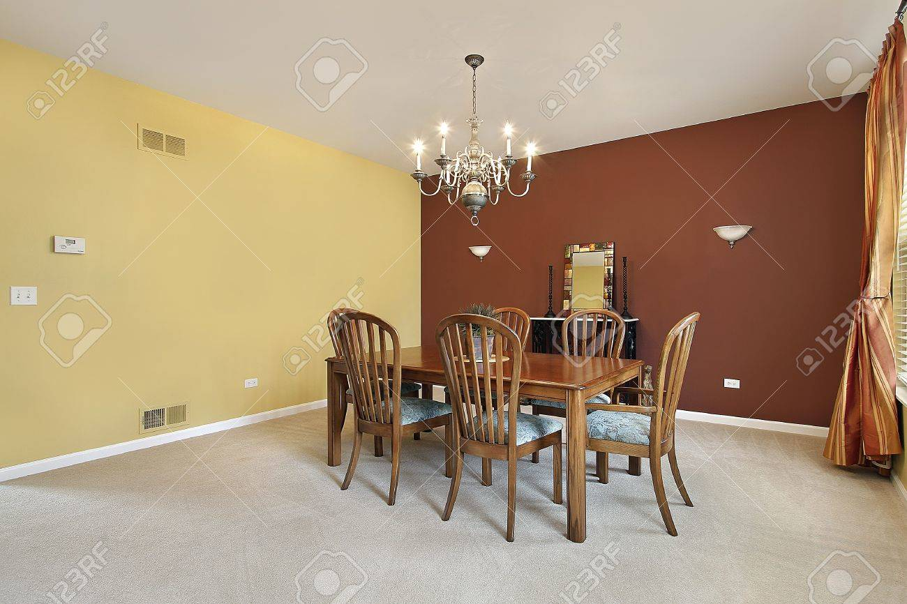 Large Dining Room With Yellow And Copper Colored Walls Stock Photo ...