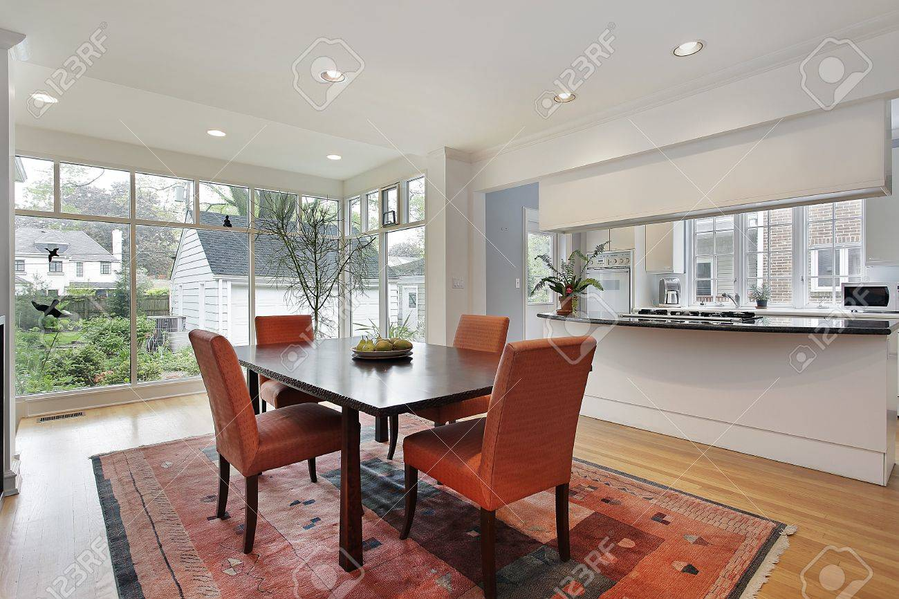 Dining room with wall of windows and orange chairs Stock Photo - 10292886