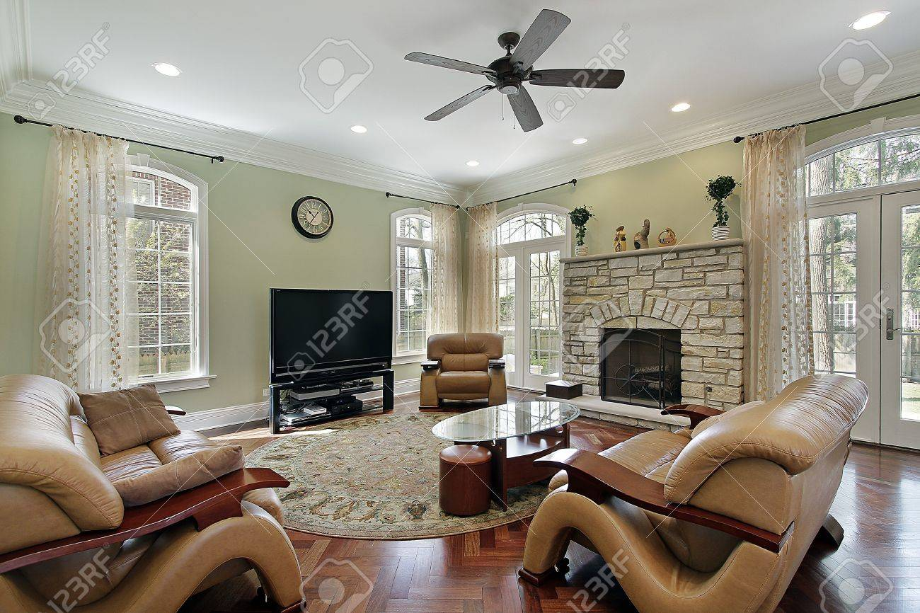 Family room in luxury home with stone fireplace Stock Photo - 10292962