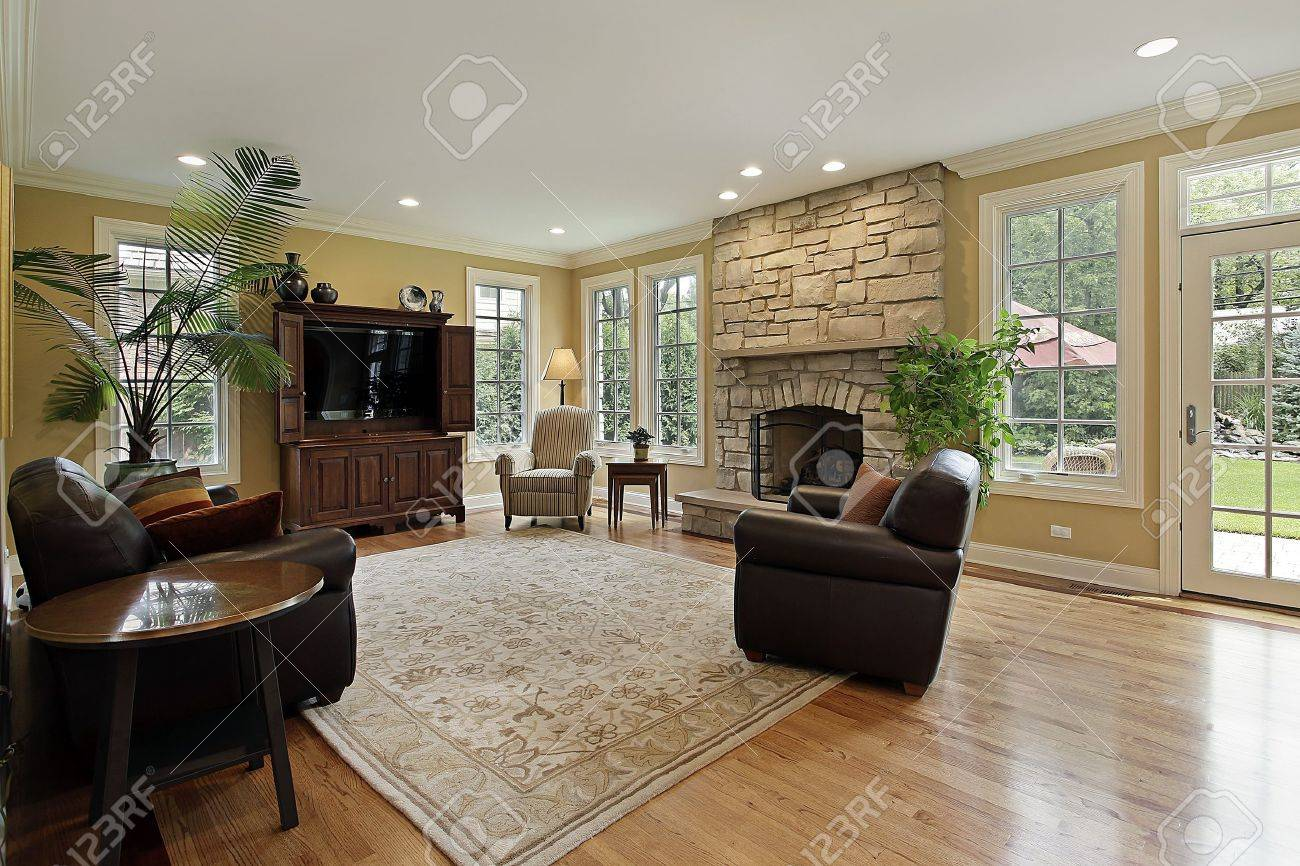 Family room in luxury home with stone fireplace Stock Photo - 10292937