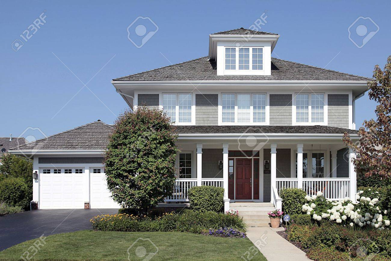 Home with front porch and cedar roof Stock Photo - 10292967