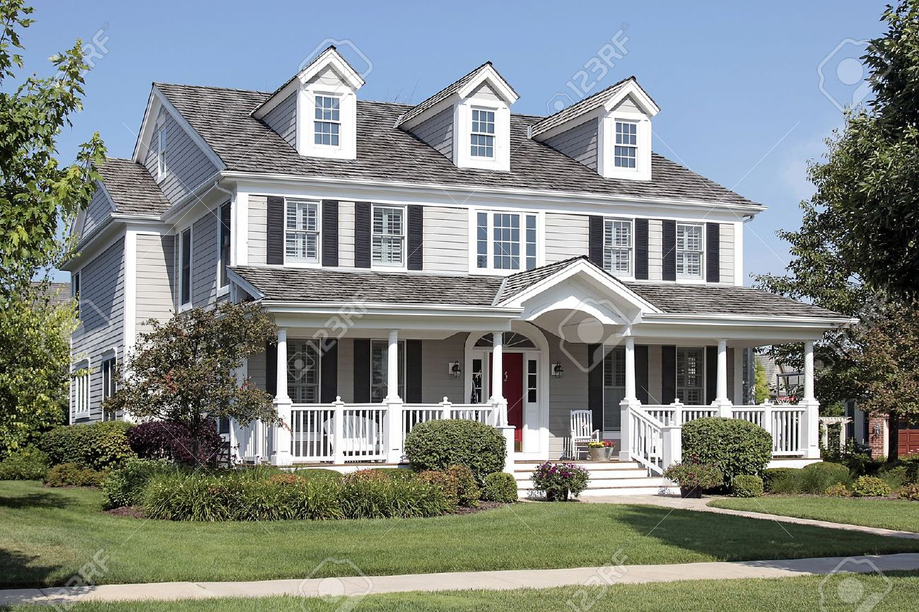 Large suburban home with front porch and arched entry Stock Photo - 10293060