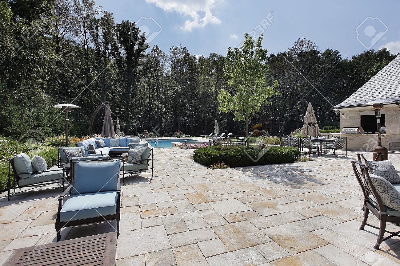Large Stone Patio Of Luxury Home With Swimming Pool Stock Photo   10293116