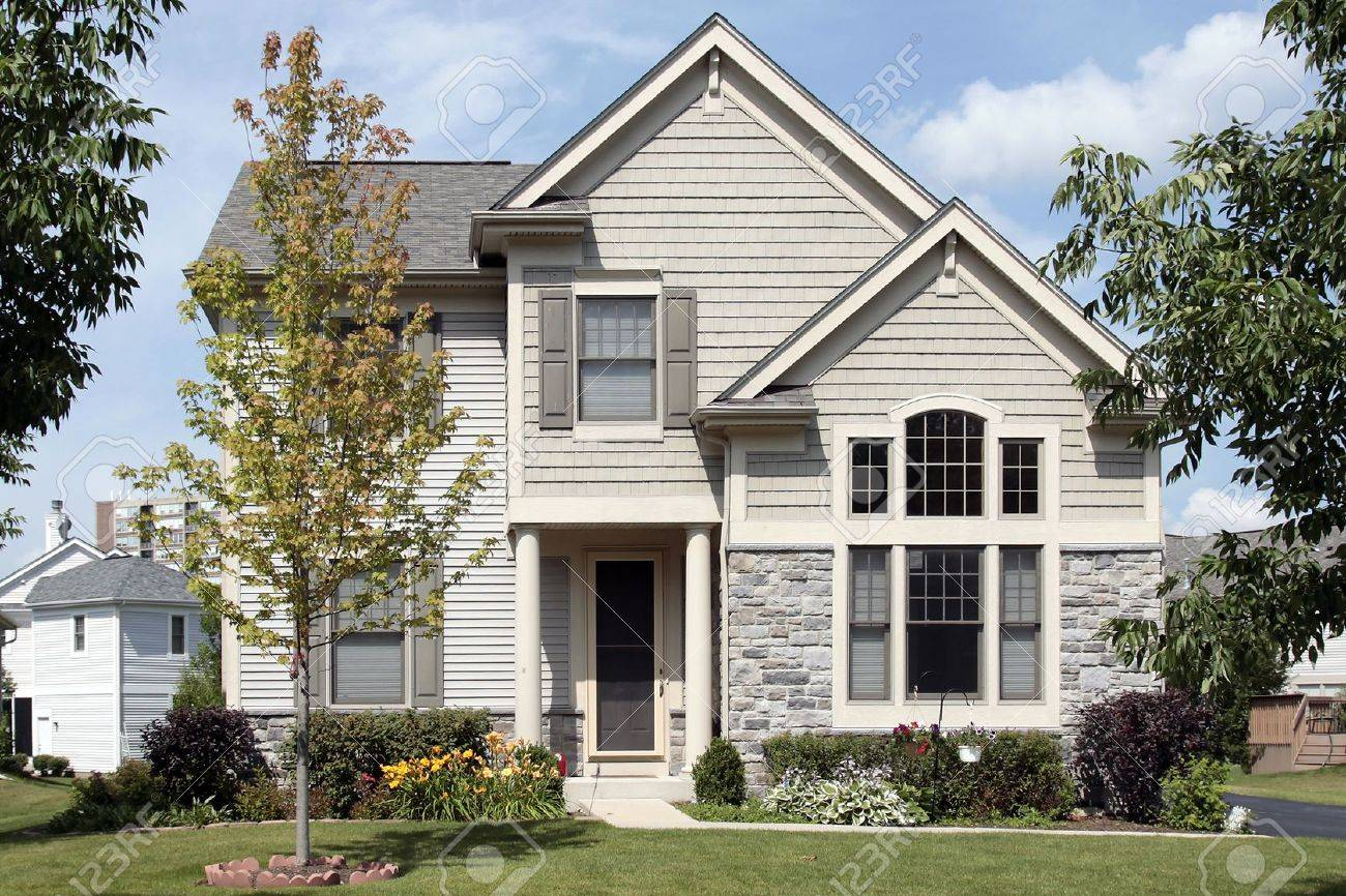 Home with tan siding and column entry Stock Photo - 8792975