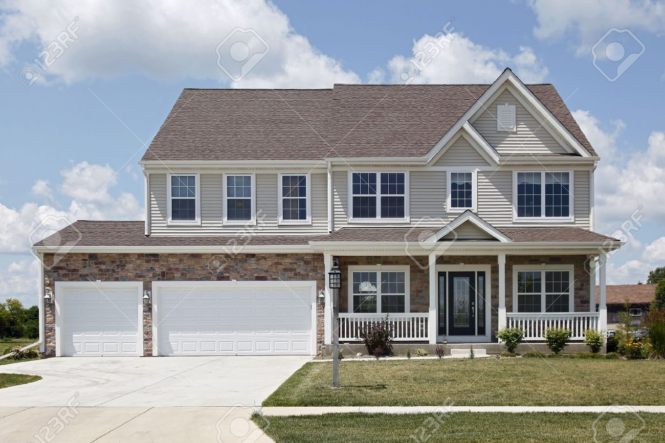 Stone two story home with front porch