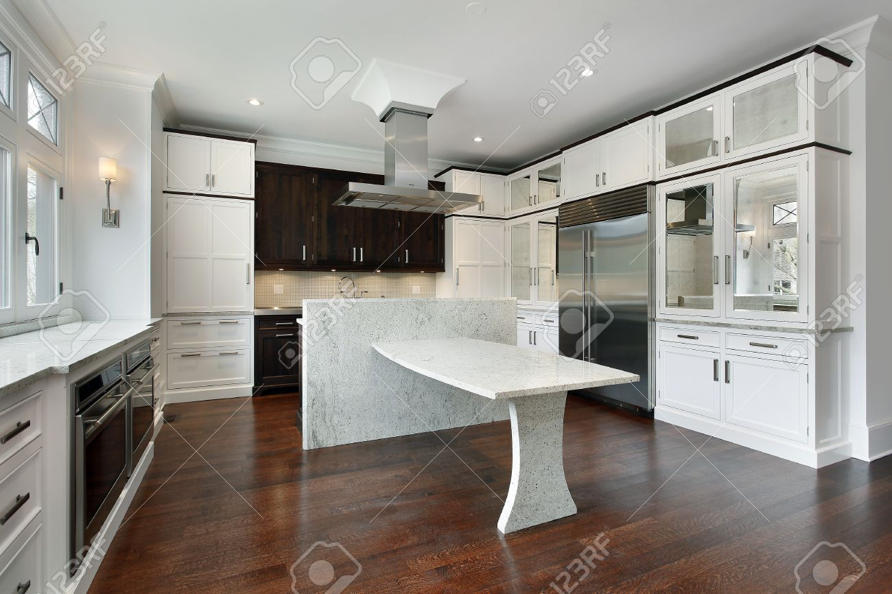 Granite Island Kitchen Modern Kitchen With White Cabinetry And Granite Island Stock Photo