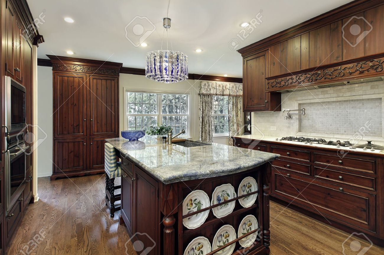 Traditional kitchen with dark wood cabinetry and granite island Stock Photo - 8792978