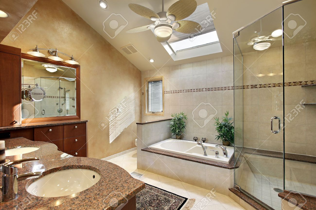 Modern Master Bath With Glass Shower And Skylight Stock Photo ...