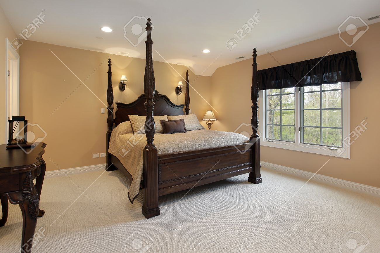 Master Bedroom Gold Walls master bedroom in luxury home with gold walls stock photo, picture