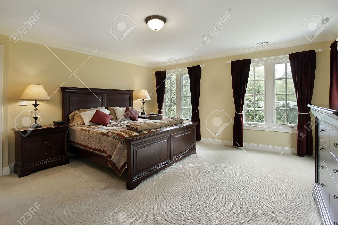 Master Bedroom In Luxury Home With Mahogany Furniture Stock Photo 8792960