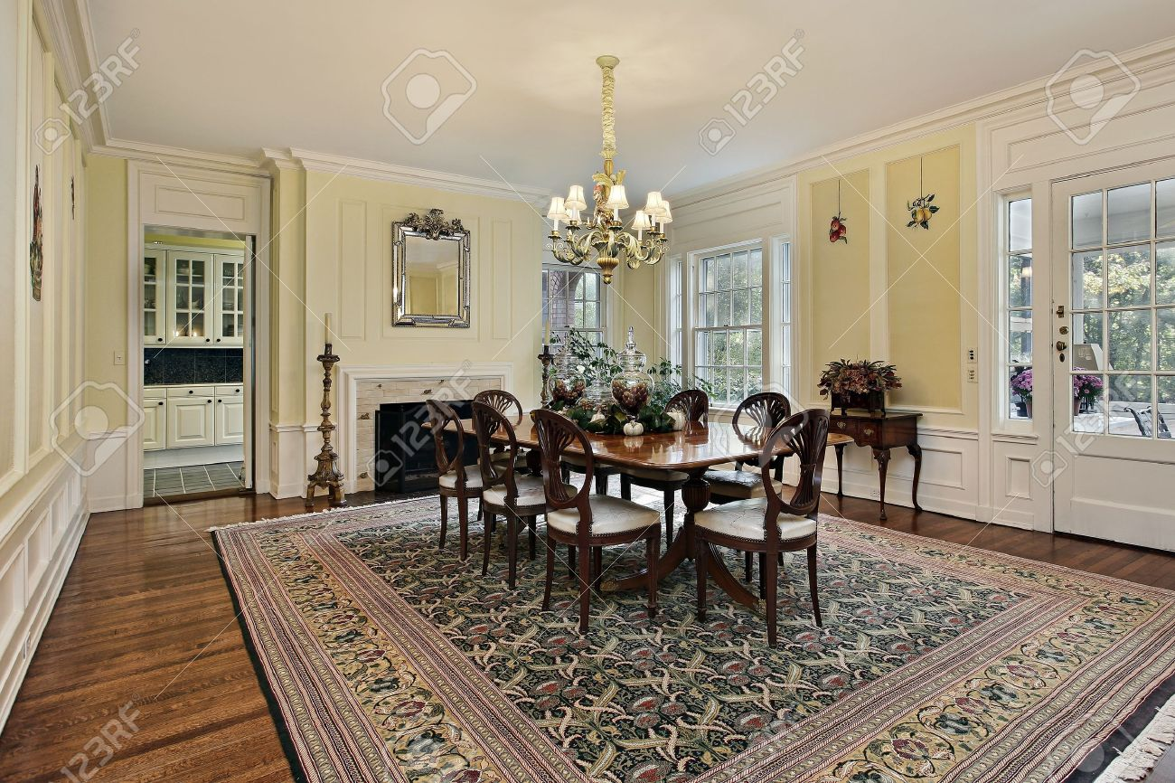 Large Dining Room In Luxury Home With Fireplace Stock Photo ...