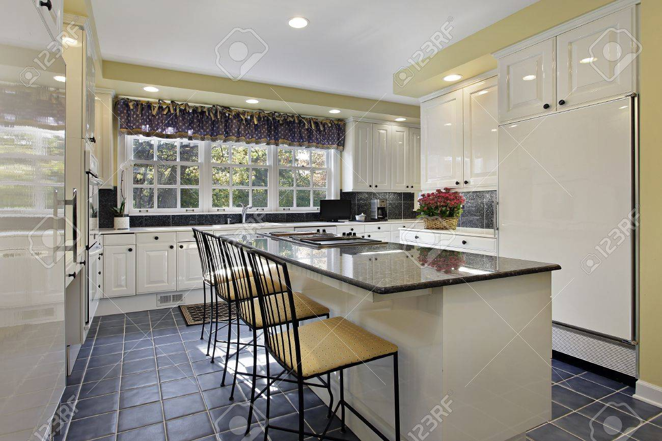 Kitchen in suburban home with granite counter Stock Photo - 10083641