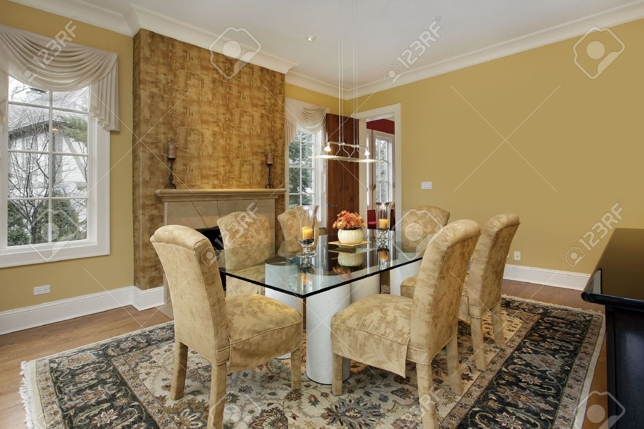 Gold Walls Living Room.Dining Room With Gold Walls And Fireplace