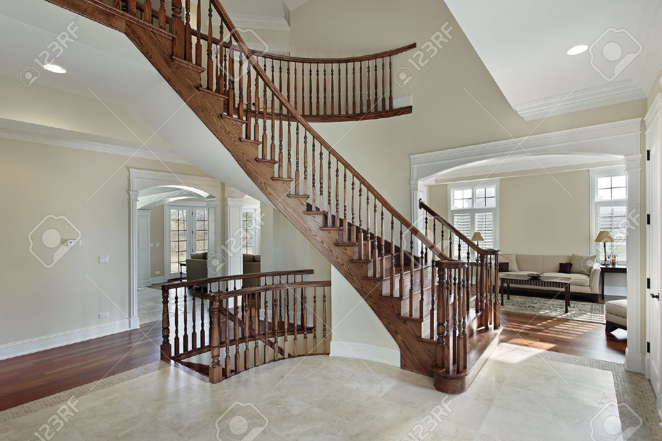 Luxury Homes Foyer foyer in luxury home with curved staircase stock photo, picture