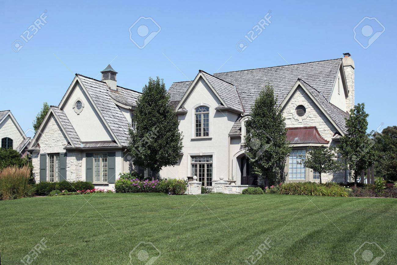 Large home with arched entry and cedar roof Stock Photo - 10537591
