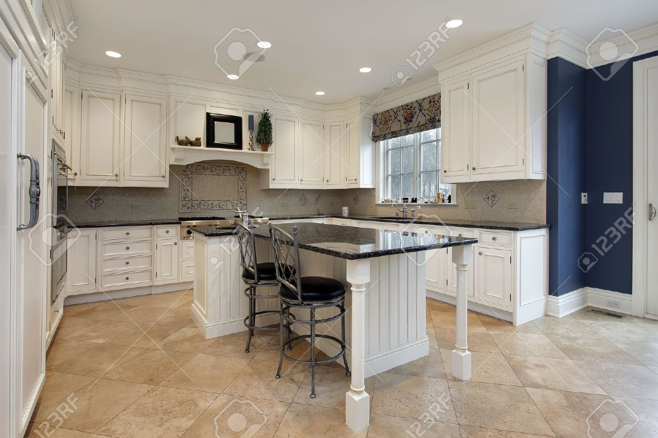 Upscale kitchen in luxury home with granite island - 10537570
