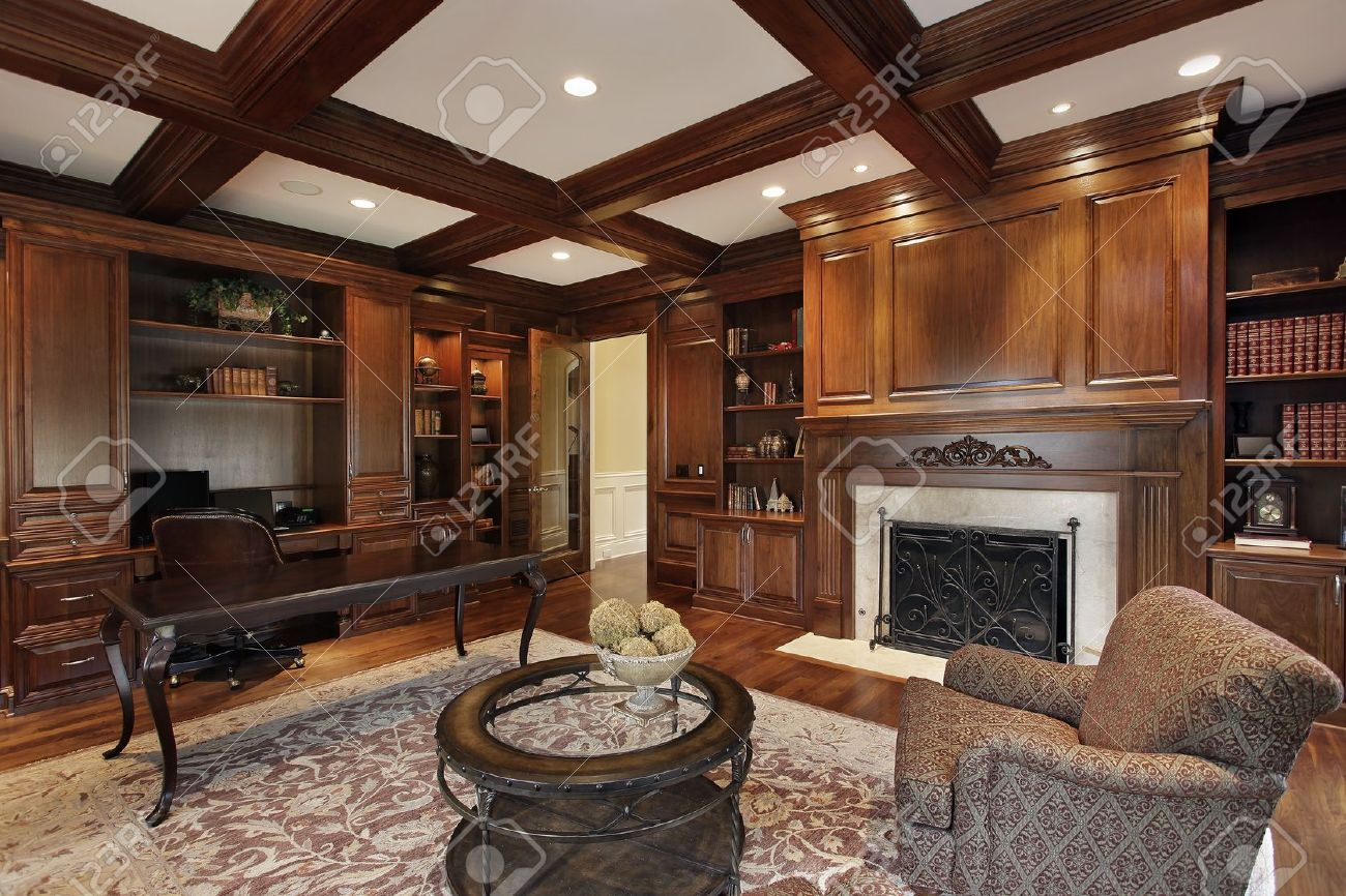 library in luxury home with marble fireplace stock photo picture