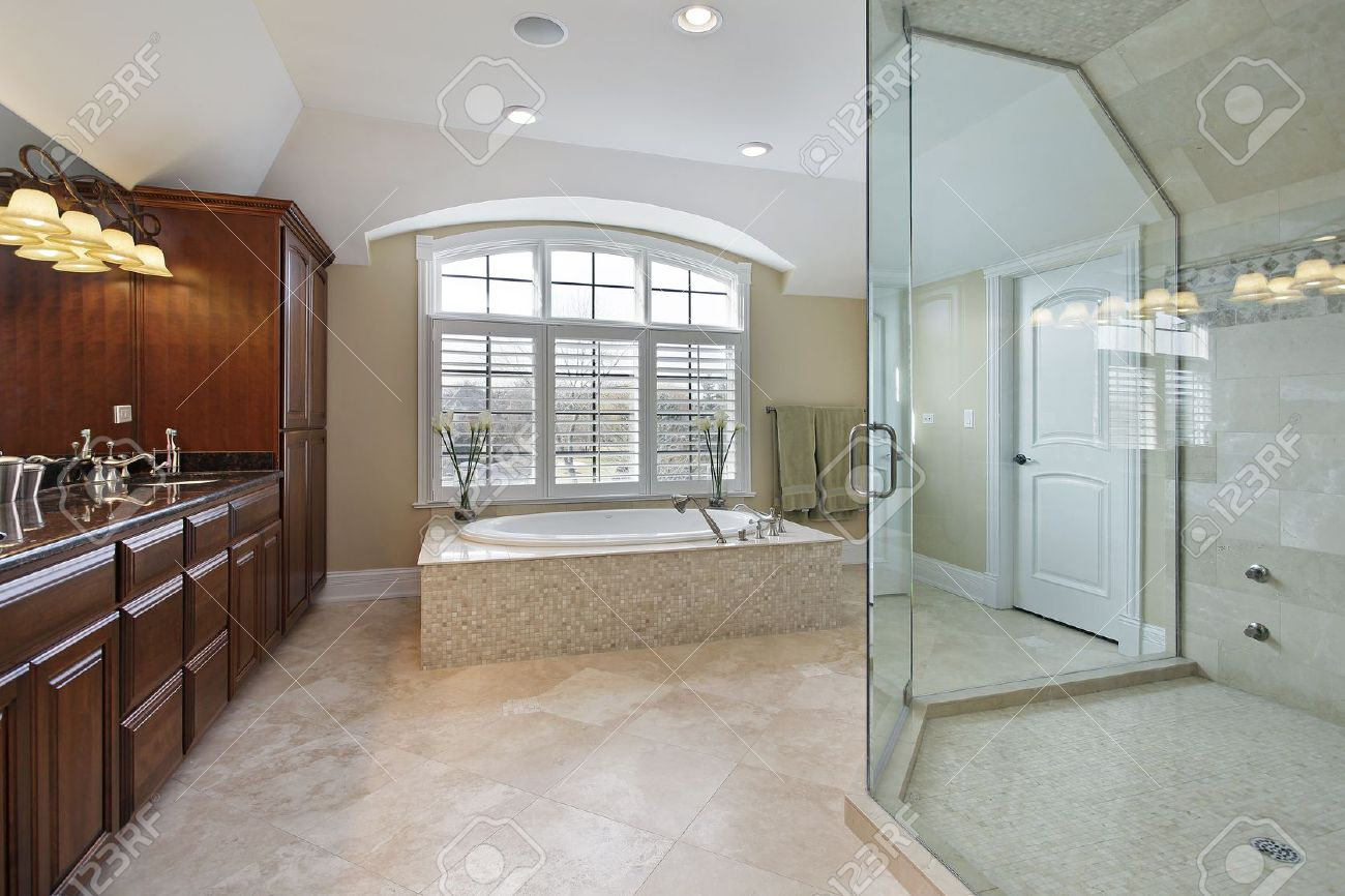 Luxury master bathroom shower - Large Master Bath With Spacious Glass Shower Stock Photo 10537560
