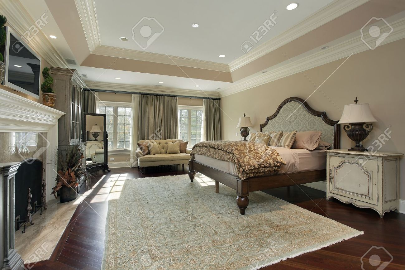 Luxury Homes Master Bedroom master bedroom in luxury home with marble fireplace stock photo