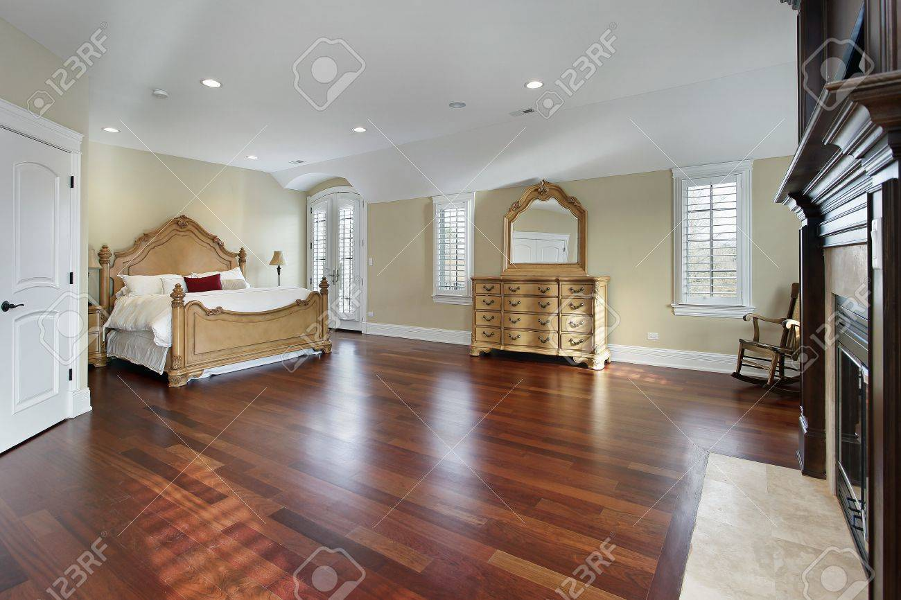 Great Large Master Bedroom With Cherry Wood Flooring Stock Photo   10537557