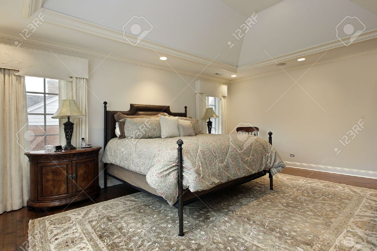 Luxury Homes Master Bedroom master bedroom in luxury home with tray ceiling stock photo