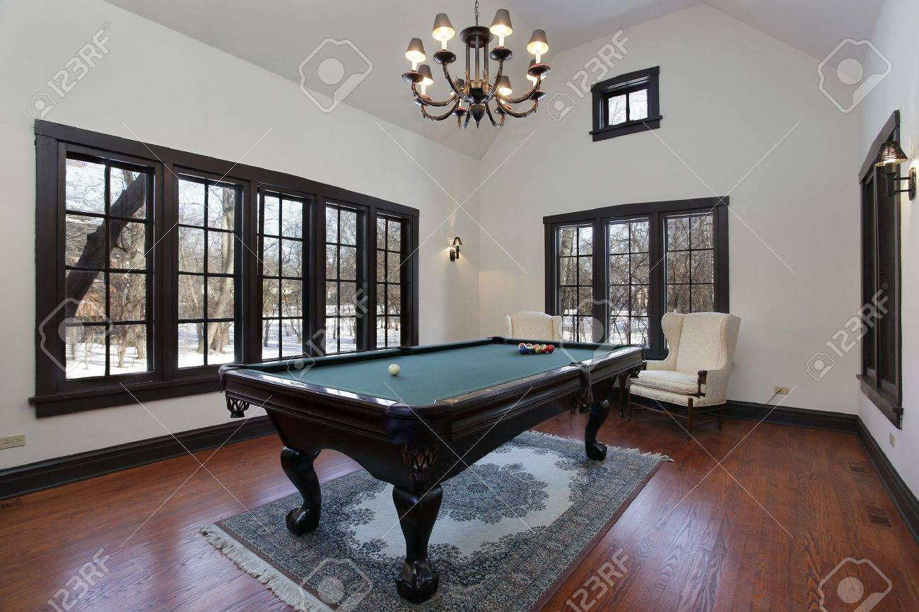 Pool room in suburban home with wall of windows Stock Photo - 10537559