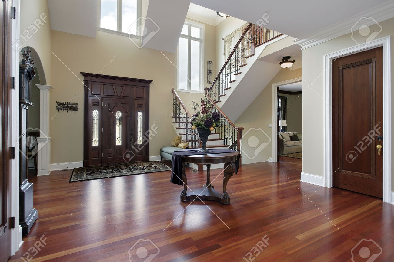 Foyer in luxury home with cherry wood flooring stock photo ...