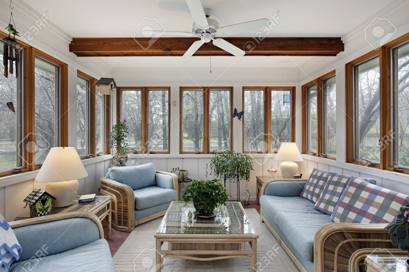 Stock Photo   Sunroom With Wood Ceiling Beam And Wicker Furniture