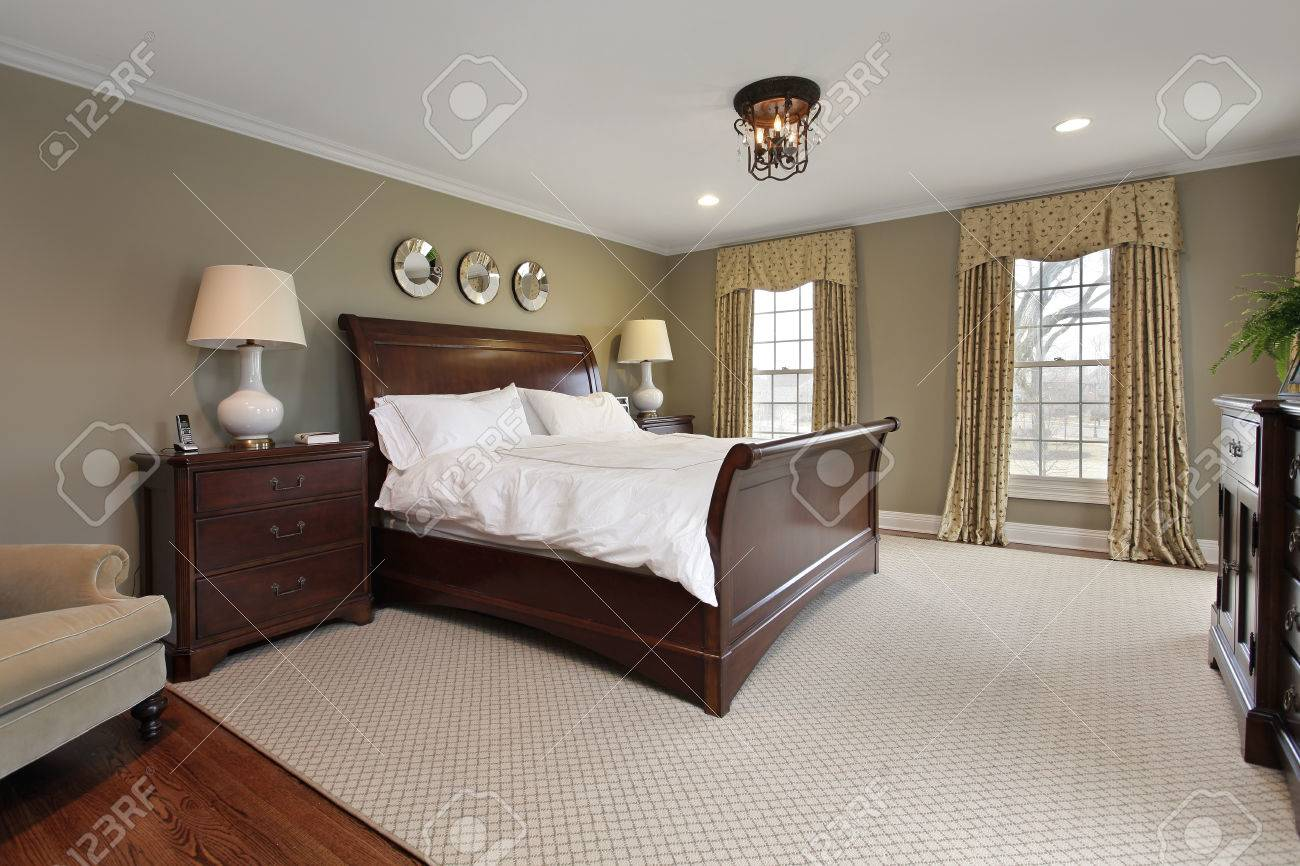 Master Bedroom In Luxury Home With Dark Wood Bedframe Stock Photo Picture And Royalty Free Image Image 50031168