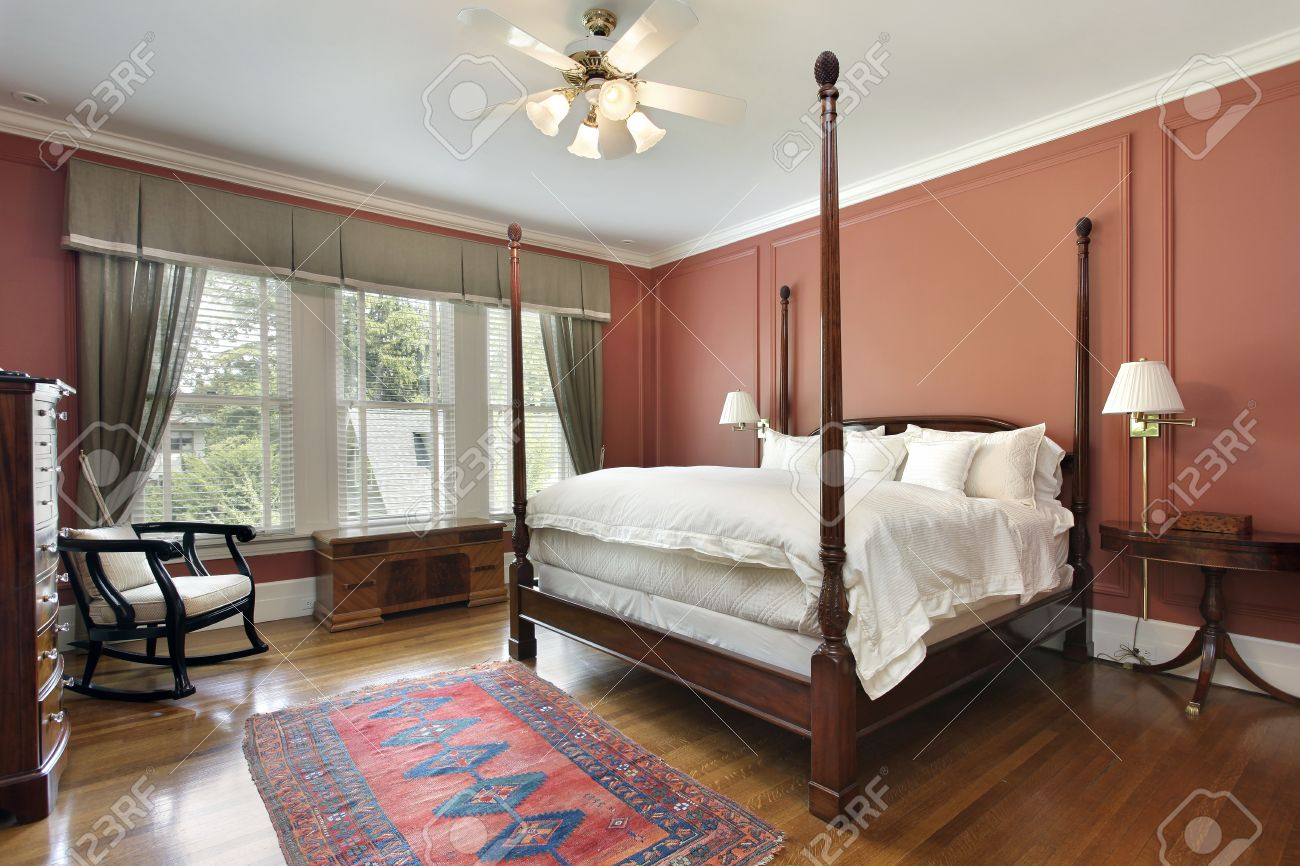 Master Bedroom In Luxury Home With Salmon Colored Walls Stock Photo    50031195