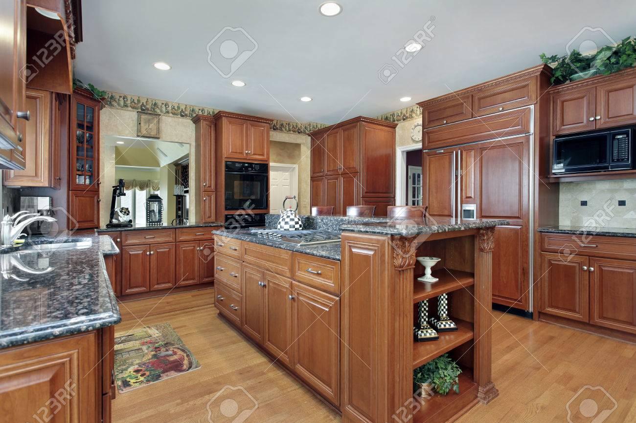 Bon Kitchen In Luxury Home With Granite Top Center Island Stock Photo   50031201
