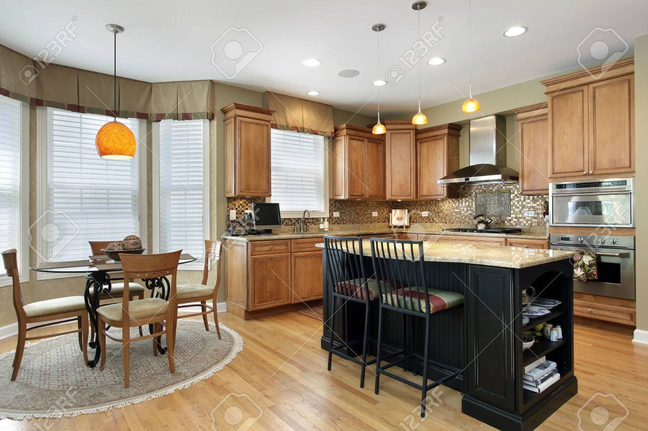 Kitchen With Oak Wood Cabinetry And Center Island Stock Photo ...