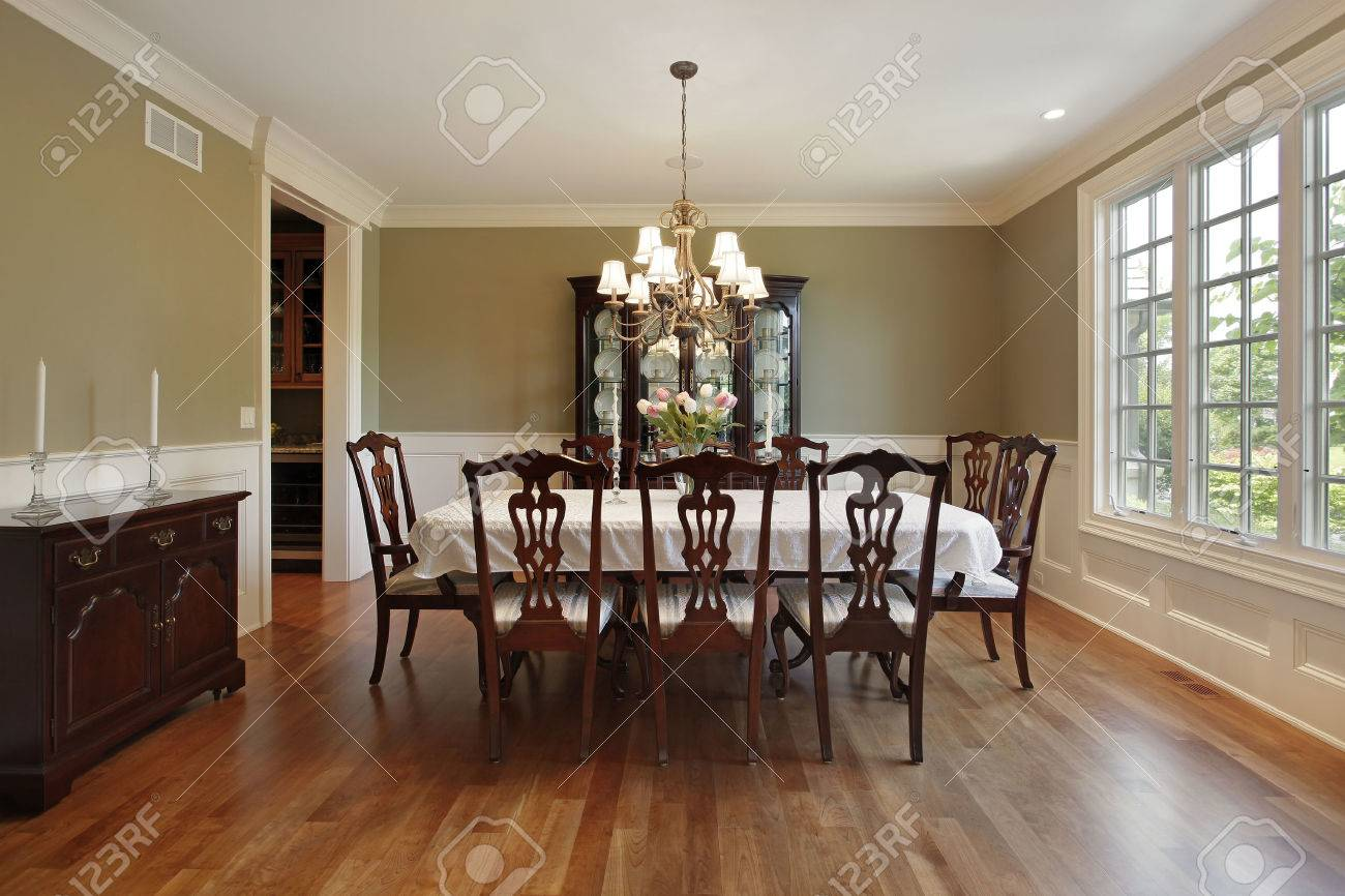 Dining room in suburban home with gold walls - 50031221