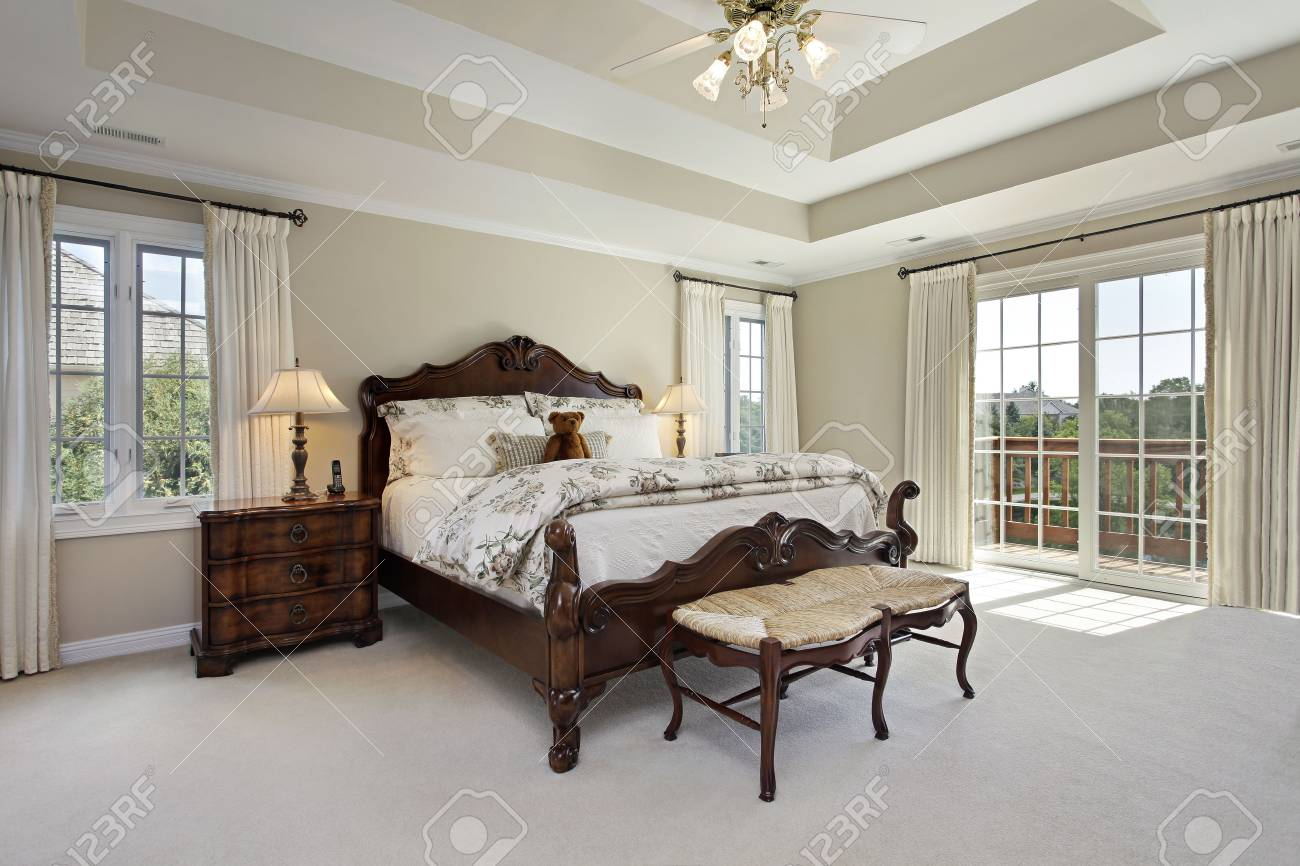 Master Bedroom In Luxury Home With Tray Ceiling Stock Photo, Picture ...