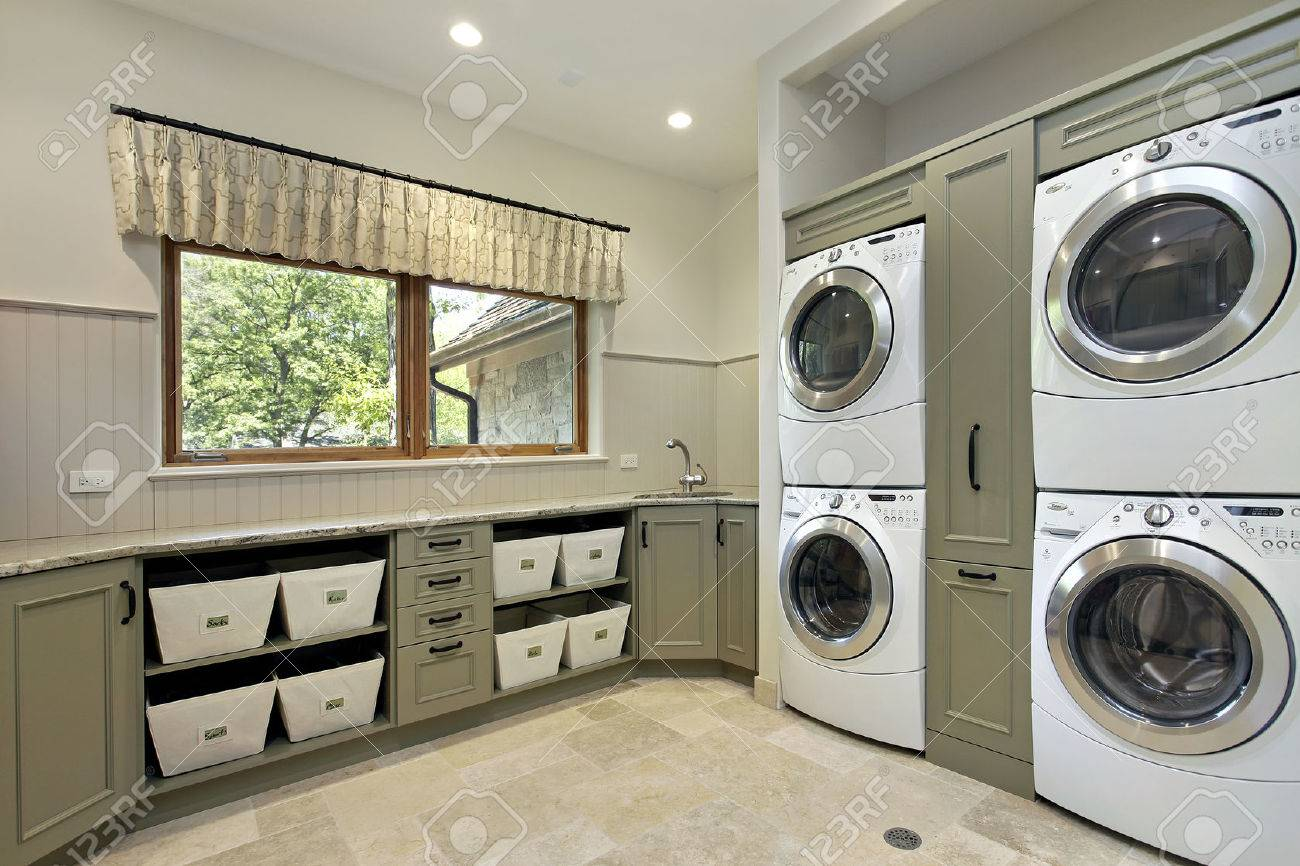 Laundry Room In Luxury Home With Dual Washerdryer Stock Photo