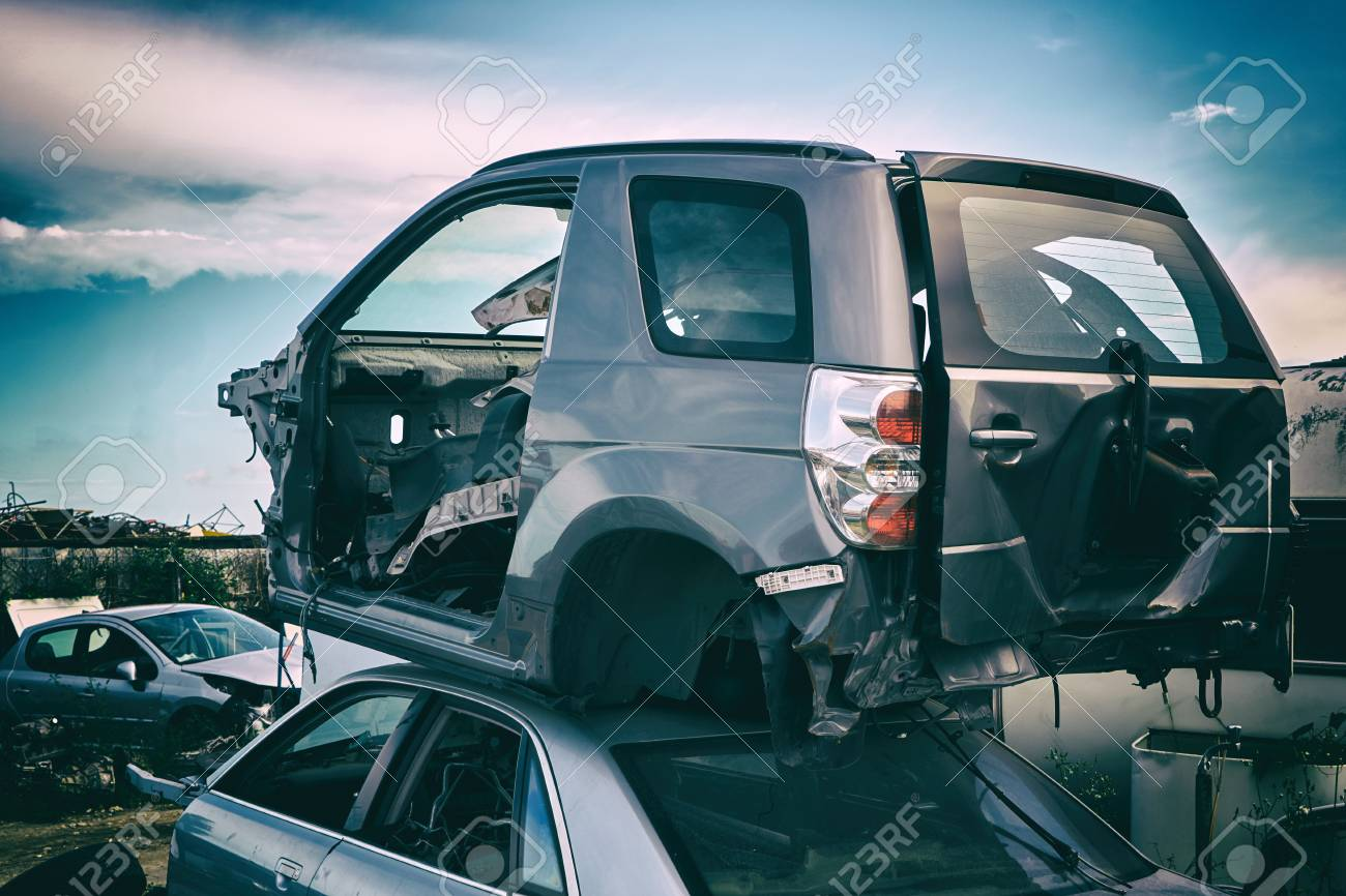 Car recycling. Dump of old cars after an accident on the road. Industrial scrap - 99233311