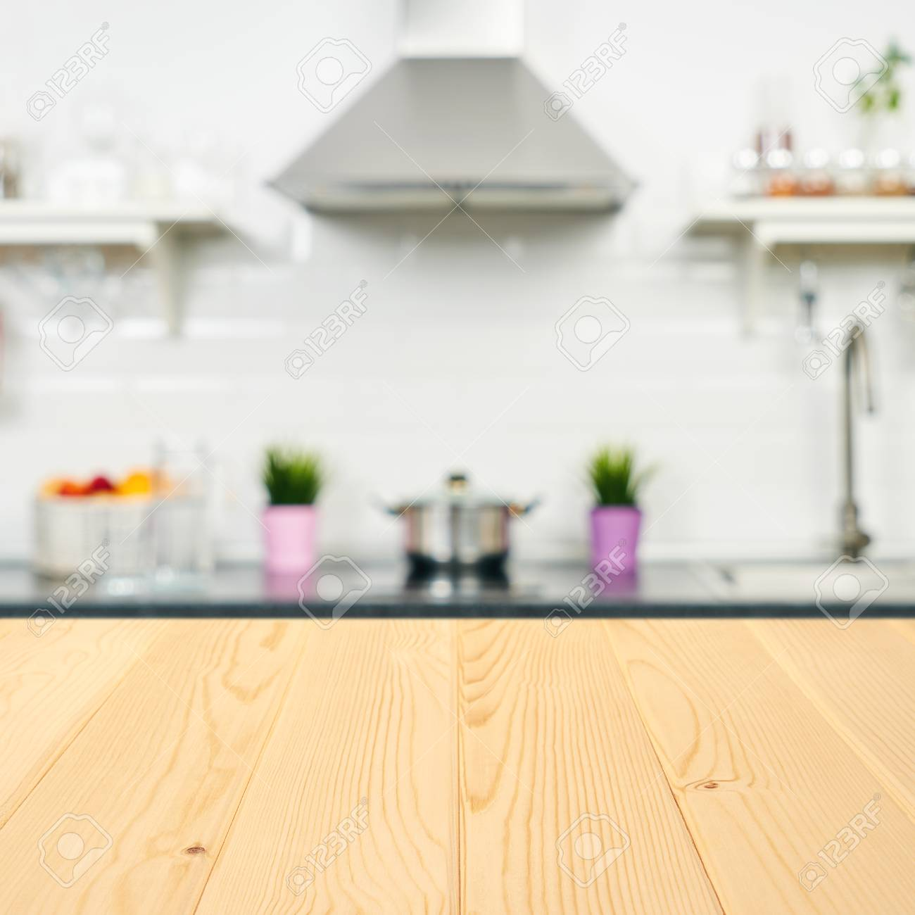 A wooden table top of the kitchen table on a blurry background..