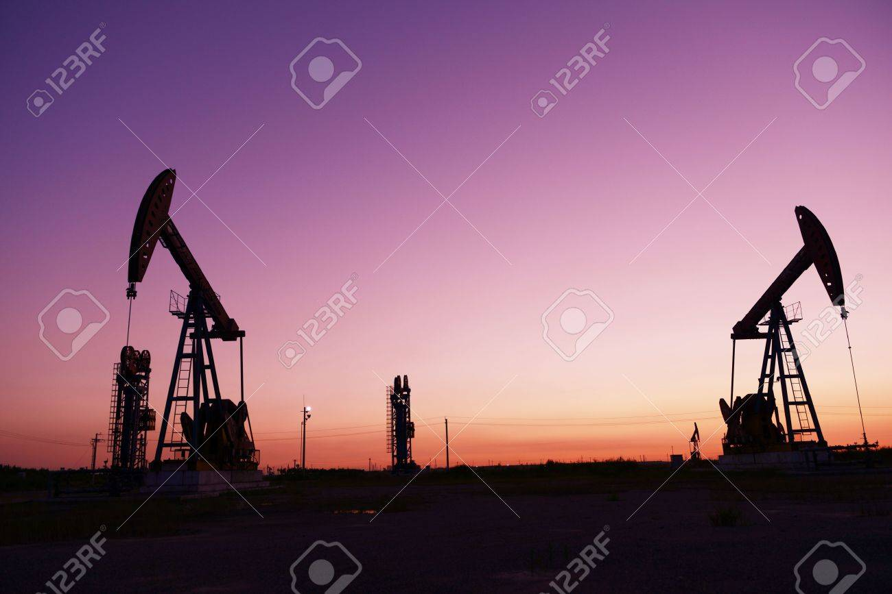 Oilfield drilling rig at sunset, jidong oil field in China Stock Photo - 22027191