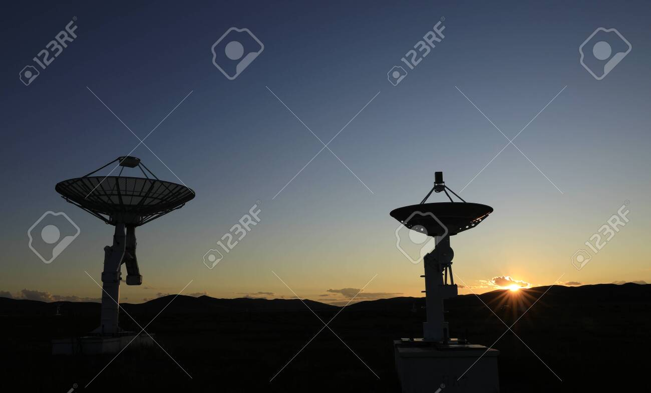 Observatory equipment in the sunset silhouette - 136434350