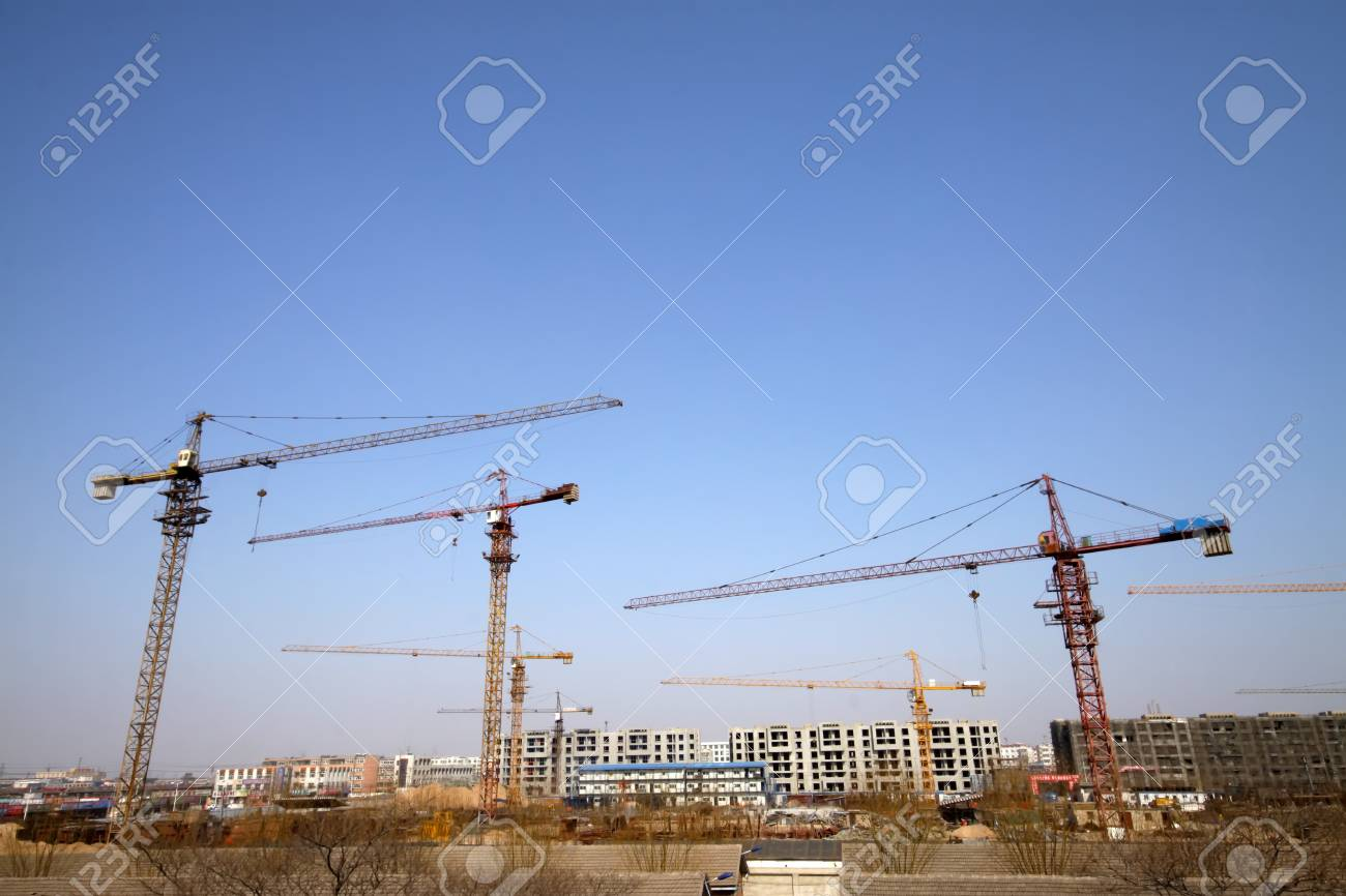 high-rise building and crane in the blue sky, very tall and spectacular. Stock Photo - 7548871