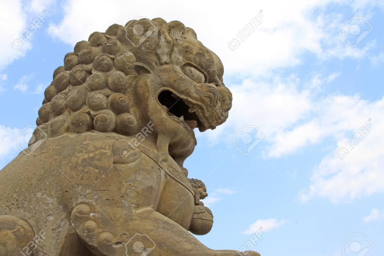 Stone lion, ancient Chinese traditional arts and crafts in a park, north china Stock Photo - 18191636
