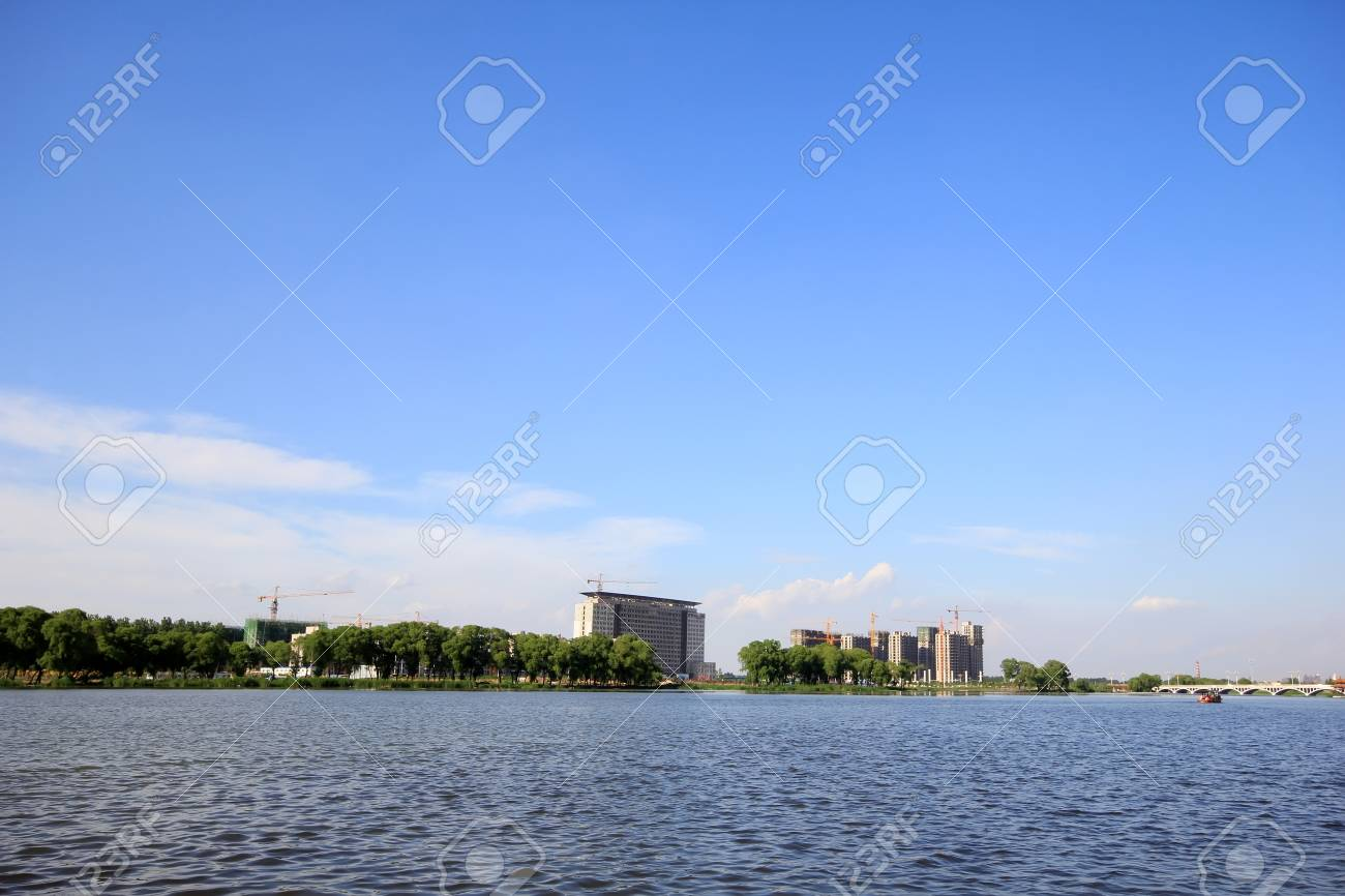 unfinished building under the blue sky by the river, north china Stock Photo - 19994895
