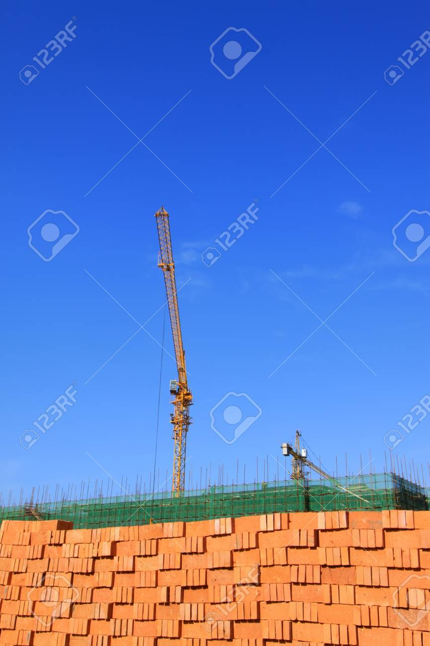 pile of bricks and the tower crane in the sky, at a construction site Stock Photo - 20489588
